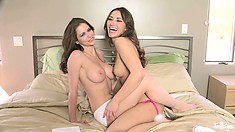 Two lezzies sparing each other from clothes in a big soft bed