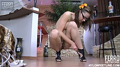 Katharine B slides on her pantyhose and her heels while dressing