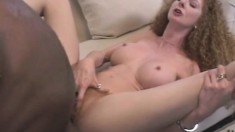 Flexible woman with great tits treats her snatch to some dark meat