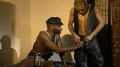 Ebony leather lover with a hot ass impales himself on a big black pole